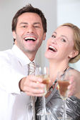 Couple laughing with glasses — Foto de Stock