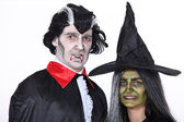 Portrait of witch and vampire — Stock Photo