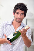 Man with bottle of champagne — Stock Photo