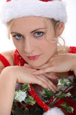 Woman with a sprig of mistletoe — Stock Photo