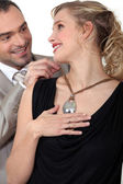 Man attaching his wife's necklace — Stock Photo