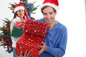 Happy man on Christmas Day — Stock Photo