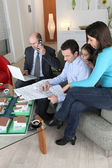 Family buying a new house — Stock Photo