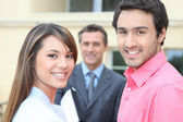 Young couple meeting with an estate agent — Stock Photo