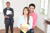 Happy young couple visiting house — Stock Photo