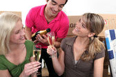House-mates celebrating move — Stock Photo