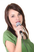 Brunette holding microphone — Stock Photo