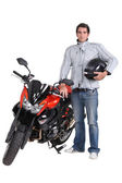Motorcyclist with his motorbike — Stock Photo