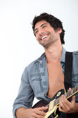 Bust shot of man with bass — Stock Photo