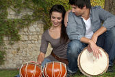 Couple with drums — Stock Photo