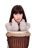 Brunette leaning on bongo drum — Stock Photo