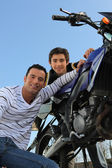 Father and son with motorcycle — Stock Photo