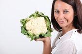Woman with cauliflower — Stock Photo