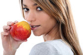 Brunette with apple — Stock Photo