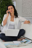 Woman booking a holiday online — Stock Photo