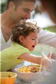 Family having breakfast in the garden — Stock Photo