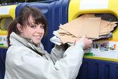 Woman using paper recycling bin — Stock Photo