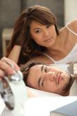 Couple slowly waking up — Stock Photo