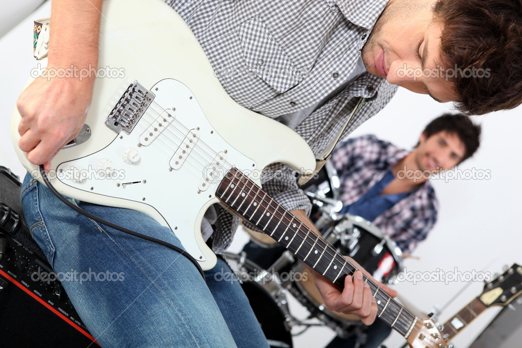 Landscape picture of guys with guitars and drums  Stock Photo #10393868