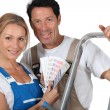 Stock Photo: Couple in working clothes