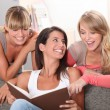Stock Photo: Girlfriends having fun at home