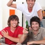 Teens with beer bottles — Stock Photo #10401330