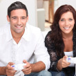 Couple playing video games — Stock Photo #10401727