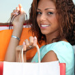 Stock Photo: Brunette holding lots of bags
