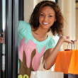 Pretty young woman shopping — Stock Photo
