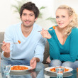 Couple sat eating pasta — Stock Photo