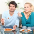 Stock Photo: Couple sat eating pasta