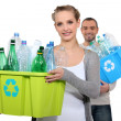 Couple taking out recycling — Stock Photo #10402707