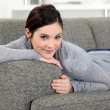 Stock Photo: Brunette chilling-out on sofa