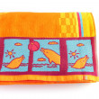 Bright orange beach towel — Zdjęcie stockowe #10404134