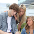 Teens taking notes — Stockfoto #10405087