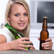 Teen with two bottles of beer - Stock Photo