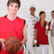 Stock Photo: Basketball player posing with other athletes