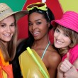 Three female friends with beachwear — Stock Photo