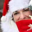 Woman with Christmas cap — Stock Photo