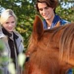 Couple stood by beautiful horse — Stock Photo #10407098