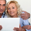 Middle-aged couple with computer — Stock Photo #10408036