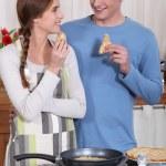 Couple eating pancakes — Stock Photo