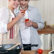 Stock Photo: Couple in kitchen with glass of wine
