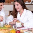 Couple having breakfast together - Stockfoto