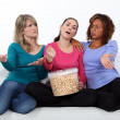 Three woman watching a movie. — Stock Photo