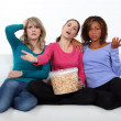 Friends watching television and eating popcorn — Stock Photo