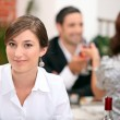 Woman eating in a restaurant — Stock Photo