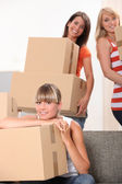Three female flat-mates packing boxes — Stock Photo