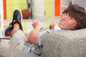 Teen watching tv — Stock Photo