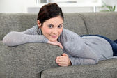 Brunette chilling-out on the sofa — Stock Photo